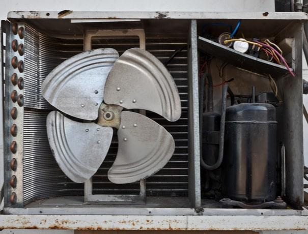 Close-up of a broken condensing unit near Avon