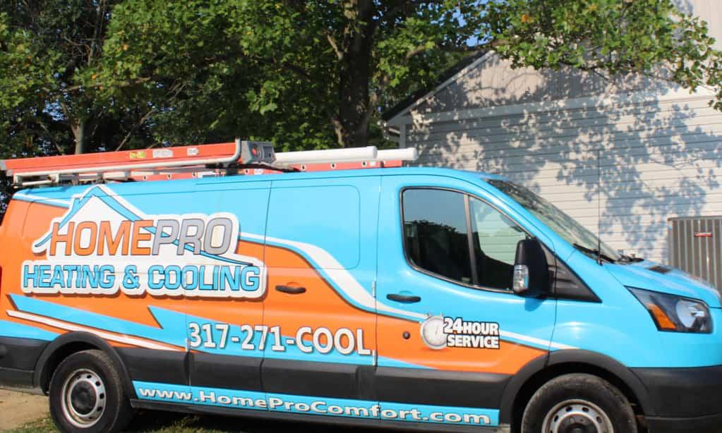 A teal and orange HomePro service van, parked in Brownsburg
