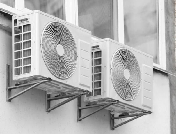 A dual ductless HVAC system on the exterior of a home in Plainfield, Indiana.