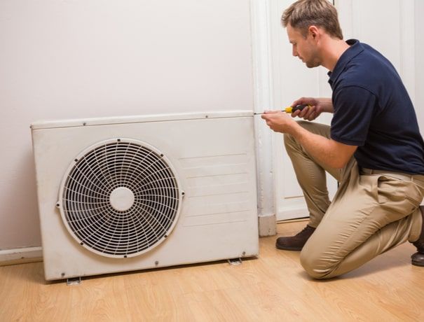A technician installs a ductless heating system in Avon, Indiana.